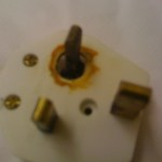 A little burnt plug, remover from a heater left running in an office in Estate agents office Milton Keynes