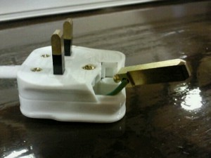 A damaged plug for a laminator still in use in a doctors surgery